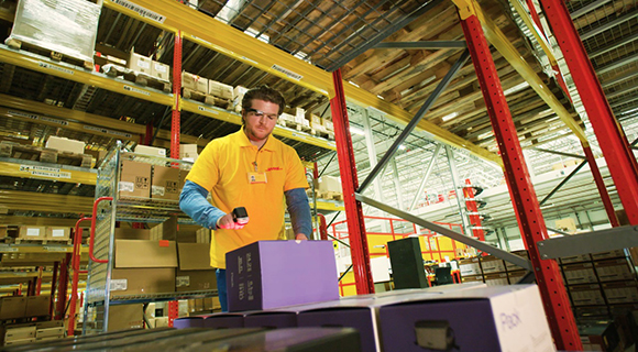 Employee working in packing and shipping facility