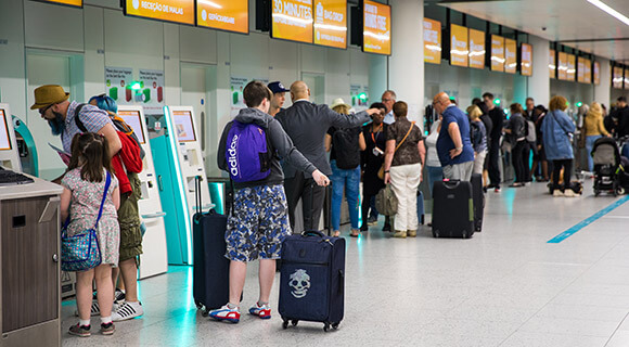 Travelers checking in at Gatwick Airport