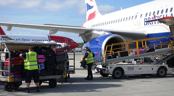 Luggage being loaded onto the plane
