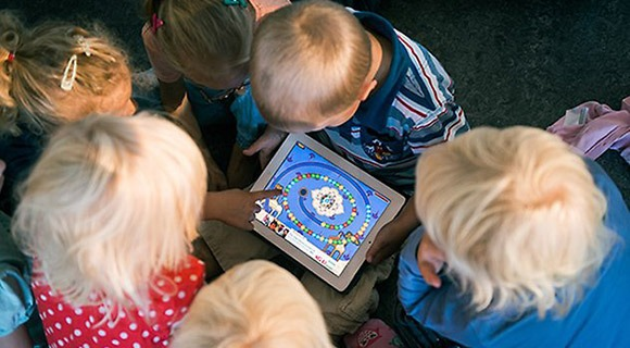 Small children playing on an iPad