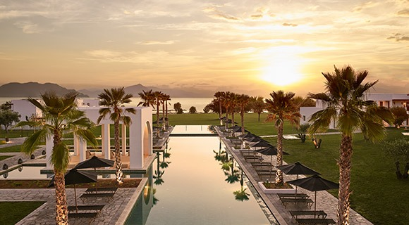 Sunset over a reflection pool at Grecotel Casa Marron