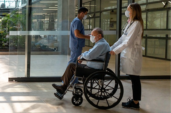Medical staff with a patient in a wheelchair