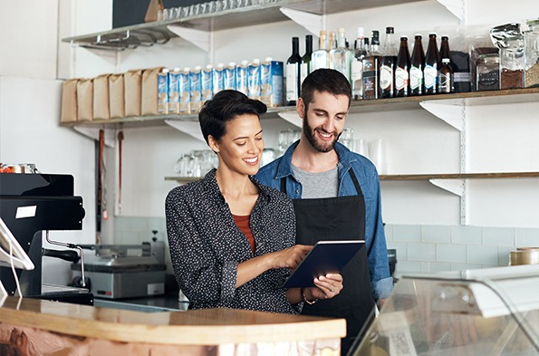 Small business owners setting up network on a tablet